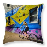 Girl Rides Bicycle Past Mural On The South Side Of Pittsburgh Throw Pillow by Amy Cicconi