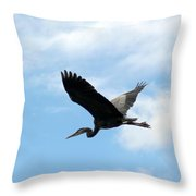 Great Blue Heron Flying Past The Clouds Above Trojan Pond Throw Pillow