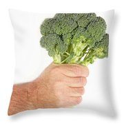 Hand Holding Broccoli Throw Pillow
