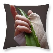 Hand With Bandage Holding Aloe Vera Leaf Throw Pillow