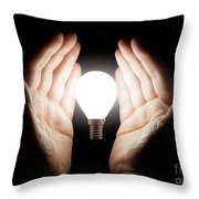 Hands Holding Light Bulb Throw Pillow