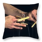 Hands Of A Puppeteer Throw Pillow by Bernard Jaubert