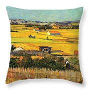 Harvest At La Crau With Montmajour In The Background Throw Pillow by Vincent Van Gogh