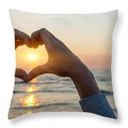 Heart Shaped Hands Framing Ocean Sunset Throw Pillow