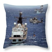 Hms Cornwall Is Pictured Receiving Stores By Merlin Helicopter  Throw Pillow
