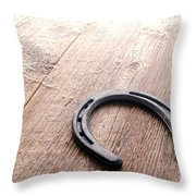 Horseshoe On Wood Floor Throw Pillow