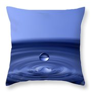Hovering Blue Water Drop Throw Pillow by Anthony Sacco