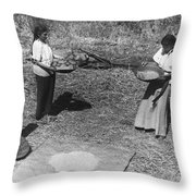 Indian Women Winnowing Wheat Throw Pillow