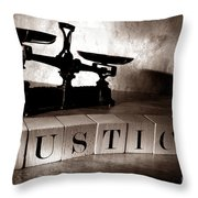Justice Throw Pillow by Olivier Le Queinec