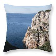 kayak in the deep of a Cala close to Calan Porter Beach - Menorca Throw Pillow