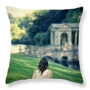 Lady Sitting On A Hill Above A Lake Throw Pillow
