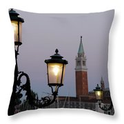 Lampposts Lit Up At Dusk With Building Throw Pillow
