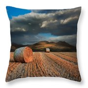 Landscape Of Hay Bales In Front Of Mountain Range With Dramatic  Throw Pillow