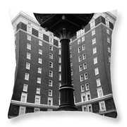 Liberty Mutual Clock With Poinset Hotel Throw Pillow