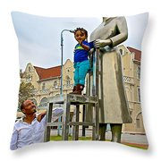 Little Girl Gets Close To Woman Sculpture In Donkin Reserve In Port Elizabeth-south Africa Throw Pillow