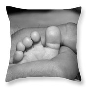 Tiny Infant Toes In Father's Big Hand Throw Pillow