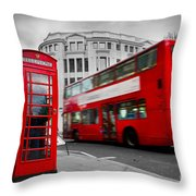 London Uk Red Phone Booth And Red Bus In Motion Throw Pillow