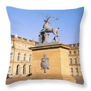 Low Angle View Of Statues In Front Of A Throw Pillow