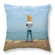 Man By The Sea With Bag On His Head Throw Pillow