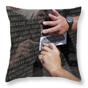 Man Getting A Rubbing Of Fallen Soldier's Name At The Vietnam War Memorial Throw Pillow