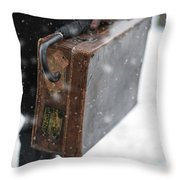 Man Holding A Vintage Leather Suitcase In Winter Snow Throw Pillow
