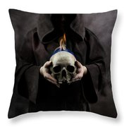 Man In The Hooded Cloak Holding Burning Human Skull In His Hand Throw Pillow