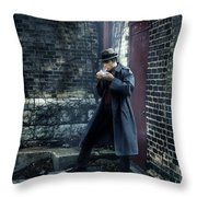 Man In Trenchcoat Lighting A Cigarette Throw Pillow
