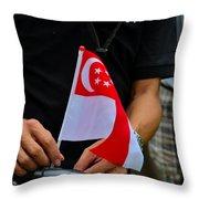 Man Plants Singapore Flag On Bicycle Throw Pillow