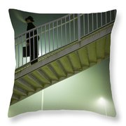 Man With Case On Steps Nighttime Throw Pillow