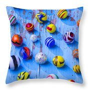 Marbles On Blue Board Throw Pillow