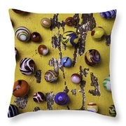 Marbles On Yellow Wooden Table Throw Pillow