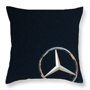 Mercedes Star On A Polished Hood Throw Pillow