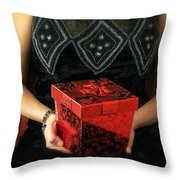 Mysterious Woman With Red Box Throw Pillow
