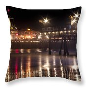 Night On Santa Monica Beach Pier With Bright Colorful Lights Reflecting On The Ocean And Sand Fine A Throw Pillow