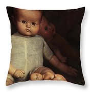 Old Dolls Sitting On Wooden Table Throw Pillow