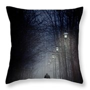 Old Man Walking On Snowy Winter Path At Night Throw Pillow by Sandra Cunningham