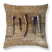 Old Nails On A Wooden Table Throw Pillow