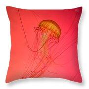 Orange Swimming Jellyfish Throw Pillow