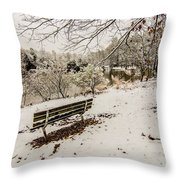 Park Bench In The Snow Covered Park Overlooking Lake Throw Pillow