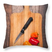 Peppers And Knife On Cutting Board Throw Pillow