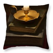 Pile Of Vintage Books By Candle Light Throw Pillow