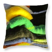 Piled Up Throw Pillow