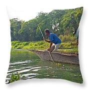 Poling A Dugout Canoe In The Rapti River In Chitwan National Park-nepal Throw Pillow