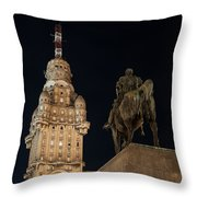 Public Statue And Skyscraper At Night Throw Pillow