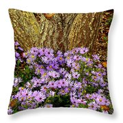 Purple Flowers At Base Of Tree Throw Pillow