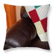 Quilt Beside A Fireplace Throw Pillow