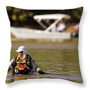Racer Wading Across A River In An Throw Pillow