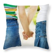 Rear View Of Girls Holding Hands Throw Pillow by Design Pics RF