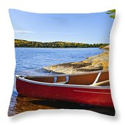 Red Canoe On Shore Throw Pillow