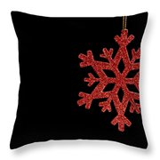 Red Snow Flake On A Black Background Throw Pillow